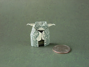 Photo: Model: Yoda; The original instructions are for a 2x1 rectangle of paper, and are easily adapted for use with a dollar bill; Creator: Marc Gutman; Folder: William Sattler; 1 dollar; Source: In the Folding section @ http://www.ftmax.com/Origami/