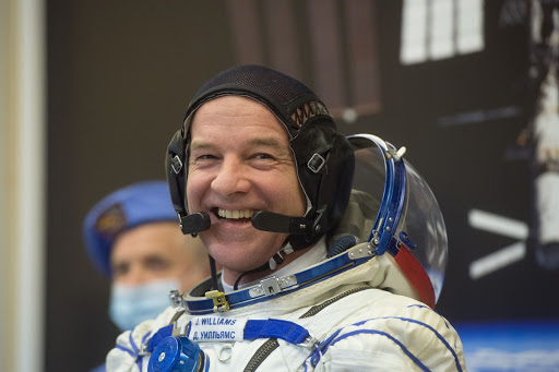Jeff Williams flashes a smile as he suits up in his Russian Sokol launch during final pre-launch training.