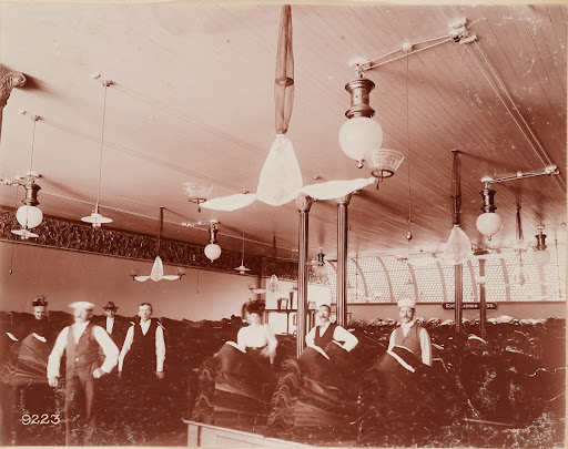 Goldstein's Clothing Store, installation of AC enclosed single and double globe lamps