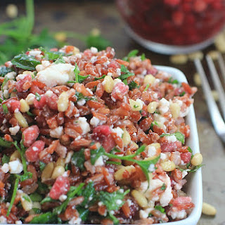 Sprouted Red Jasmine Rice Salad with Pomegranate, Feta, Pine Nuts, and Fresh Herbs.