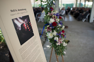 Photo: A memorial tribute from the Smithsonian is seen at the entrance of a private memorial service celebrating the life of Neil Armstrong, Aug. 31, 2012, at the Camargo Club in Cincinnati. Armstrong, the first man to walk on the moon during the 1969 Apollo 11 mission, died Saturday, Aug. 25. He was 82. Photo Credit: (NASA/Bill Ingalls)