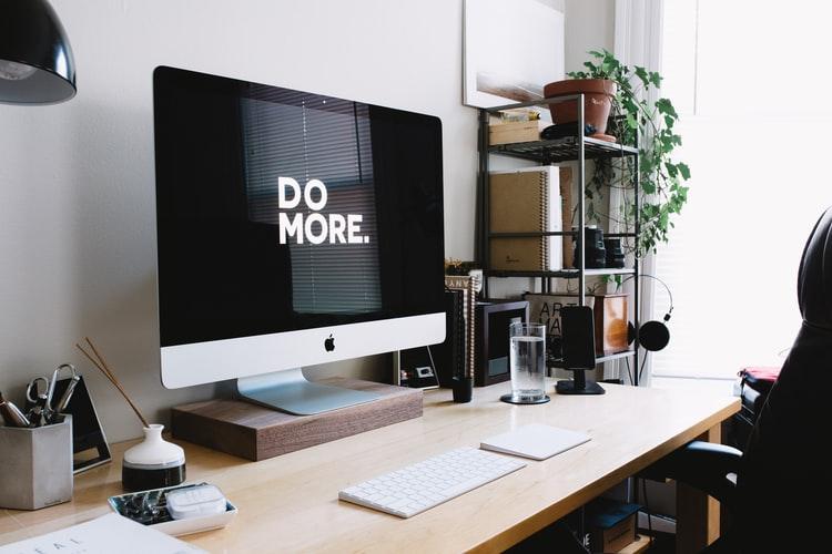 desktop screen with a sign do more