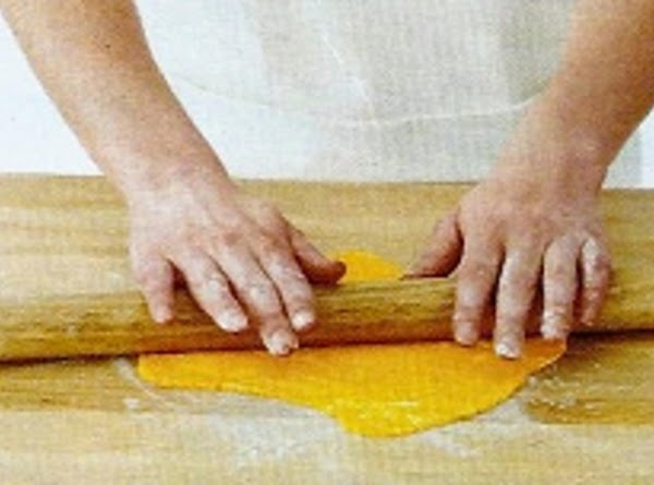 Make the cheese: Roll out the orange fondant on a cornstarch-dusted surface to about...