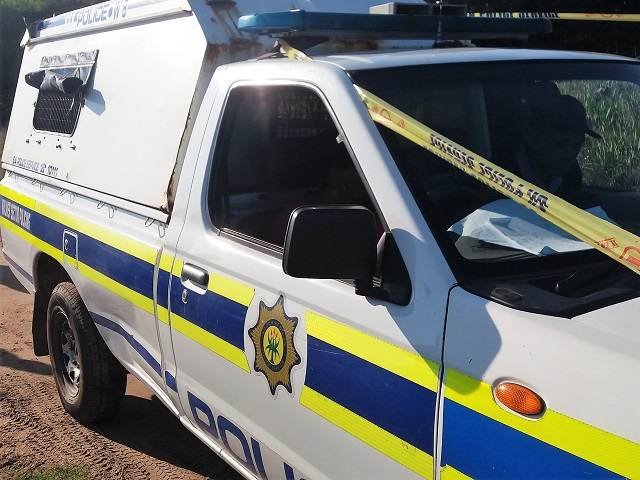 Police are investigating an armed robbery after two men robbed a bus depot and made off with several vehicle radios