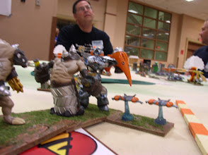 Photo: Defender X moves in aggresively with G1 Strike Fighter Support to turn the Molemen Behemoth (who now will recoil onto the side of his Behemoth brother). Jonathan Bostwick, Guard Commander is in the background.