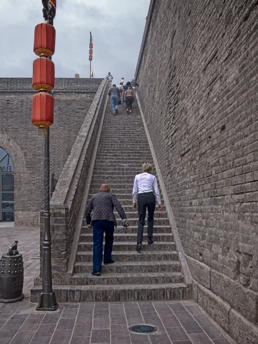 Photo: Stairway To . . . The City Wall The only way to get there.  Members of our tour group make their way up the stairs to the top of the city wall in Xian. This stop was just after lunch, making the climb . . . unattractive. Once ascended, though, there are interesting views of the surrounding city, and interesting activities going on. Worth the effort, indeed.  #Travel   #China   #Xian
