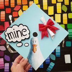 """A graduation cap that reads """"Mine."""""""