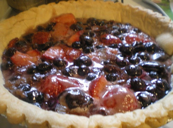 Remove from oven and allow to cool to room temperature while preparing cheesecake layer.
