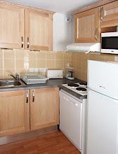 Photo: Coin cuisine d'un appartement de la résidence