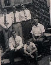Photo: back (L-R) Fr. Jim, cousin Jim Comerford, uncle Jim Naughton. seated cousin John Kelly, brother Mike, father Mike