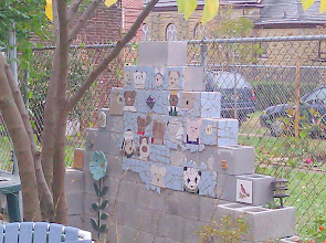 Photo: I made a tile mosaic of Maureen's bear collection.   I know this is a rather crazy thing to do, but I was able to spare some time. I wanted to see if I had the skill.   Eventually the wall, which runs the length of our yard will all be tiled (but not all with bears).