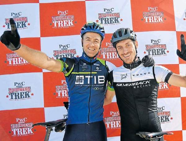 Andrew Hill, left, and Shaun-Nick Bester celebrate after taking overall honours in the three-day PwC Great Zuurberg Trek mountain-bike race, which finished at Zuurberg Mountain Village near Addo yesterday