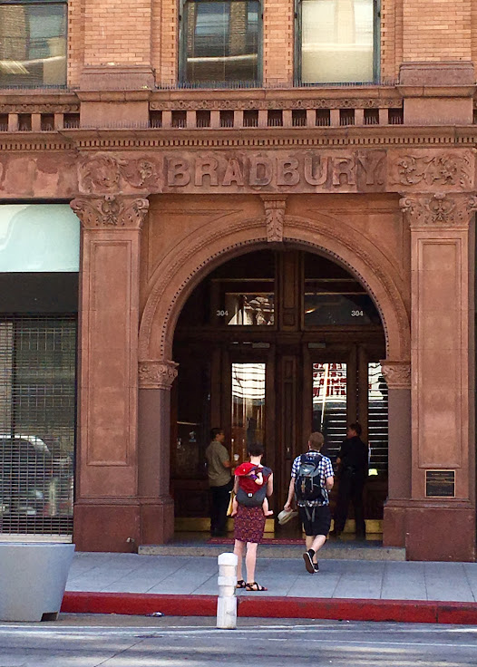 Head into the Broadway entrance of the Bradbury Building.