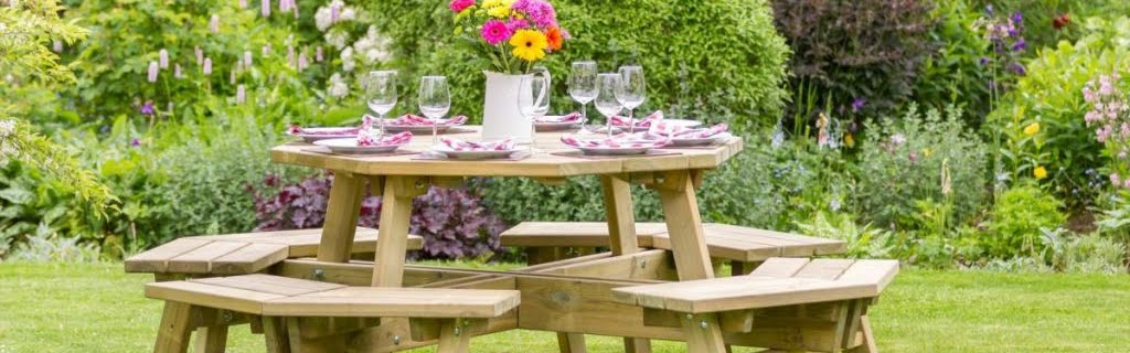 a round picnic table in a garden