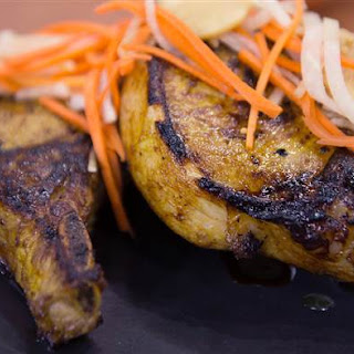 Maple-Turmeric Pork Chops with Pickled Carrots and Daikon.
