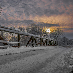 Cold Iron  by Bob White - Buildings & Architecture Bridges & Suspended Structures ( bridge snow sunset clouds love sun,  )