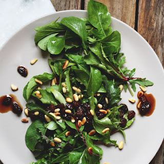Spring Greens with Balsamic Soaked Raisins and Pine Nuts