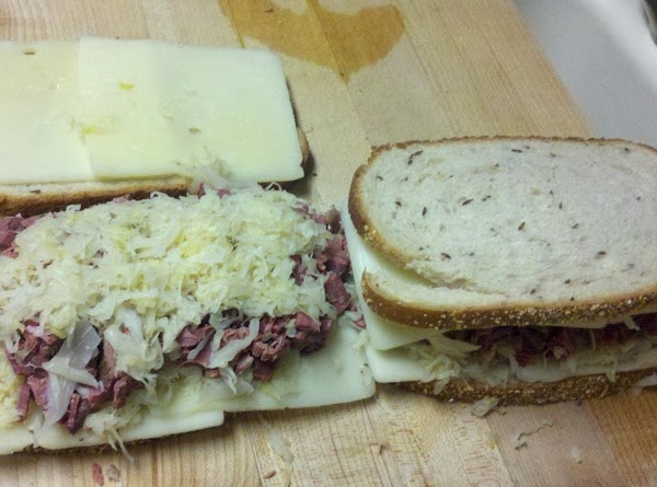 Assemble sandwiches by starting with 2 slices of swiss cheese on each side of...