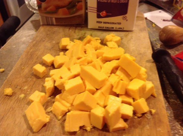 NOW ADD THE CUBED Velveeta cheese, AND STIR TO BLEND INTO SOUP MIXTURE. Continue...