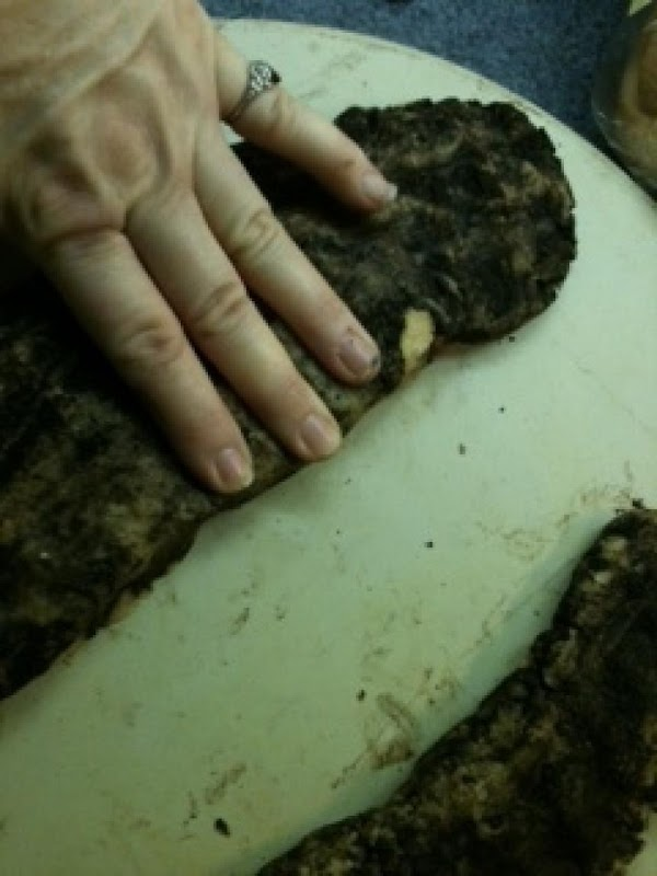 Wash excess choc dough off your hands and blend the almond dough placing two...
