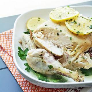 Easy Crock Pot Roasted Chicken w/ Lemon Parsley Butter.