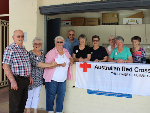Pat Woods, third from left, was presented with a $250 Coles voucher by Narrabri Red Cross president Kath Davis. With them are Red Cross members Harold Davis, David Streeter, Pat Hardgrave, Dianne Streeter, Bette Panton, Dawn Armstrong and Jan Holmes.