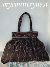 Photo: borsa in panno di lana color cioccolato con interno trapuntato
