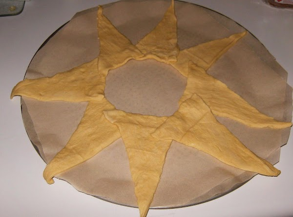 On round pizza pan lay crescent rolls out in sun burst pattern. I used...