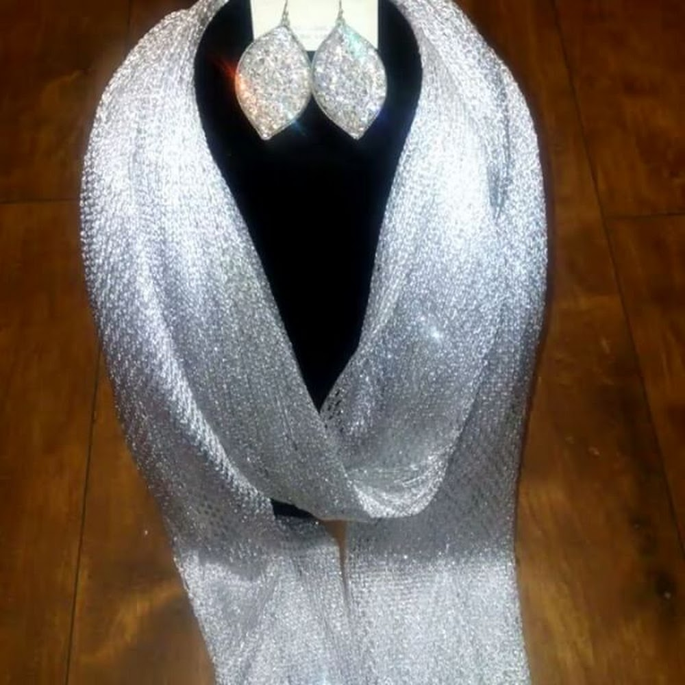 The perfect holiday gift! Cute shimmer scarf with matching earrings.