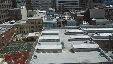 Photo: Вид из номера. Слева детская площадка на крыше китайской школы.