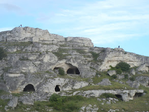 Photo: Closer up view of cave dwellings on the other side of the ravine.