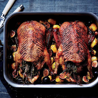 Roast Ducks with Potatoes, Figs, and Rosemary.