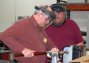 Photo: Steve works with a skew to cut the pen blank.