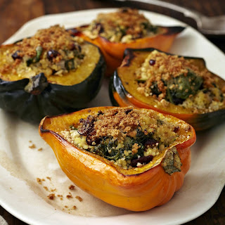 Stuffed Acorn Squash with Millet, Spinach, Cranberries, and Hemp Seeds.