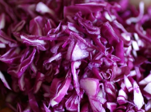 Shred the cabbage into thin slices, mix with olive oil, red wine vinegar, salt,...