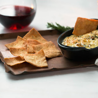 Baked Fontina Dip with Stacy's® Parmesan Garlic & Herb Pita Chips.