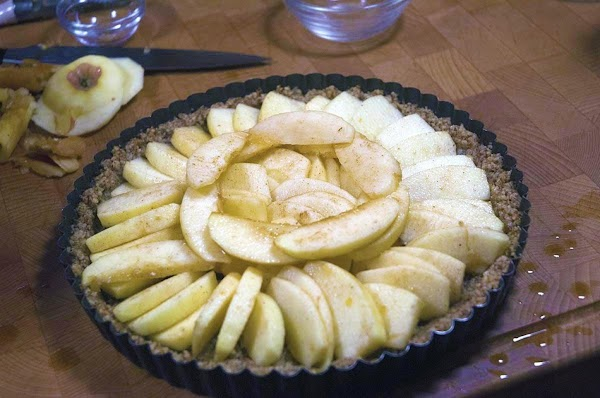 Remove the apples, one at a time, shake off any excess liquid, and place...