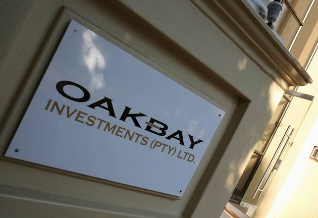 A logo of Oakbay Investments is seen at the entrance of their offices in Sandton, outside Johannesburg.