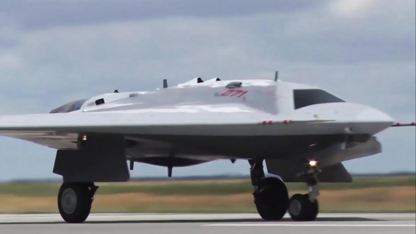 Russian Military Unveils Stealth Drone's Maiden Flight ...