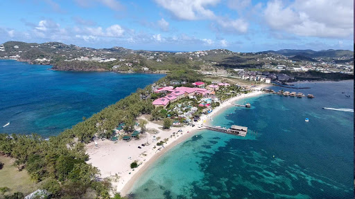 drone-sandals-pigeon-island.jpg - Sandals Resort (light red rooftops) and Pigeon Island Beach in the northwest corner of St Lucia (drone image).