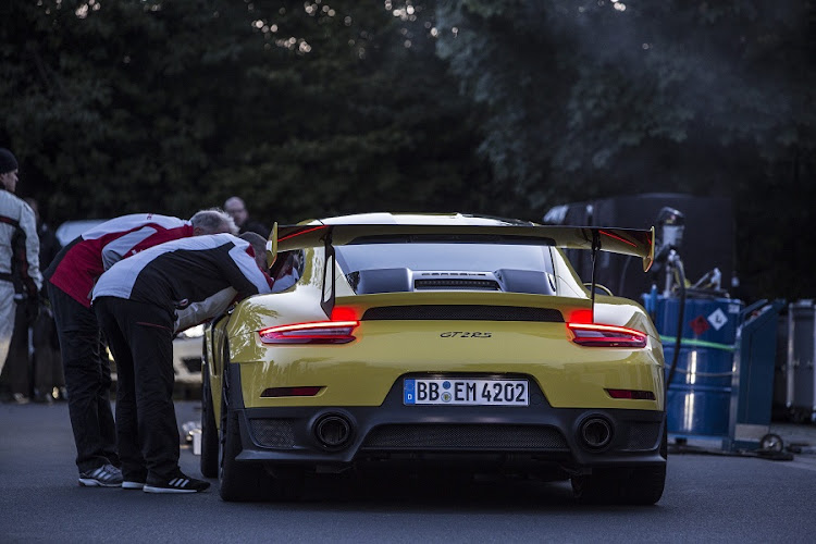 The crew attend to the car during the record attempt. Picture: PORSCHE