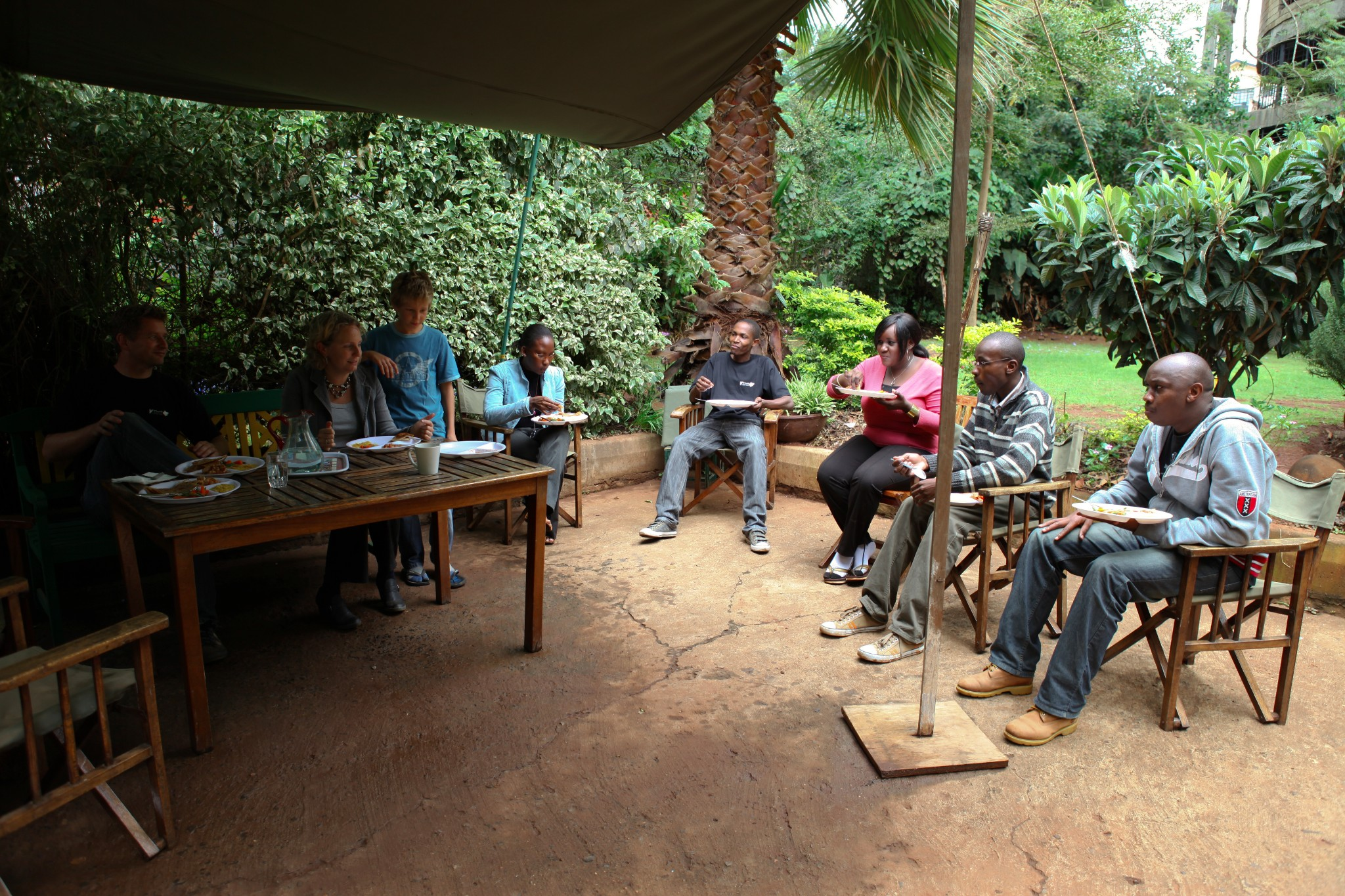 Photo: Mark De Blois, his family, and the Upande team treated me lunch at his house.