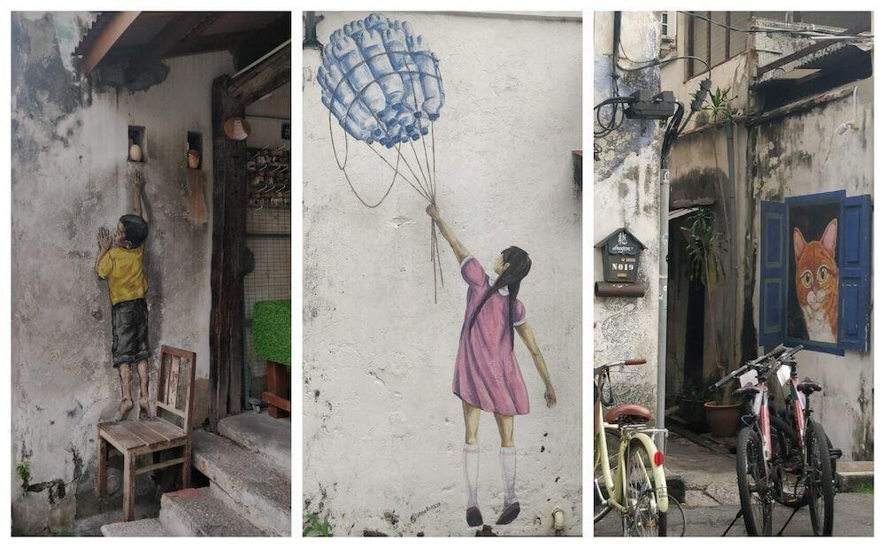 boy+and+girl+reaching+up+cat+looking+street+art georgetown penang+malaysia