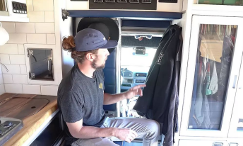 man discussing how he turned an ambulance into a tiny home