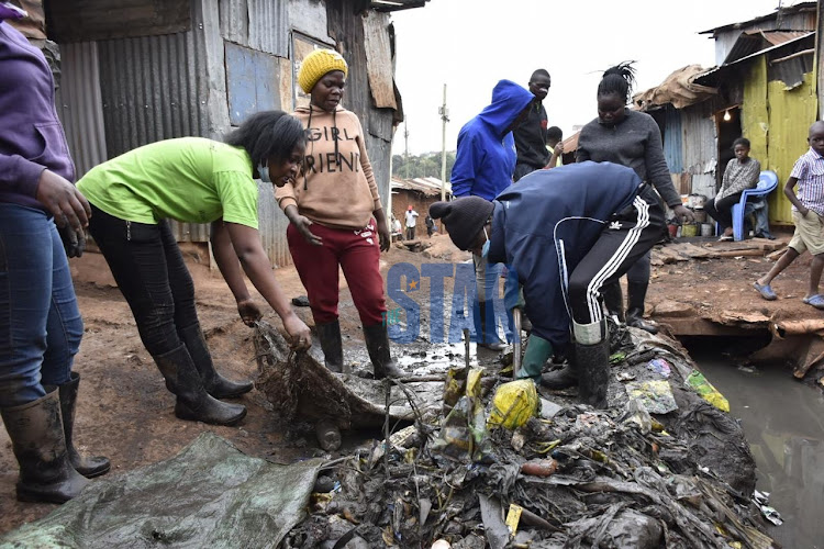 Youths from Kibera Katwekera area take part in Kazi Mtaani program that is meant to create employment for them during this coronavirus pandemic period on July 16,2020