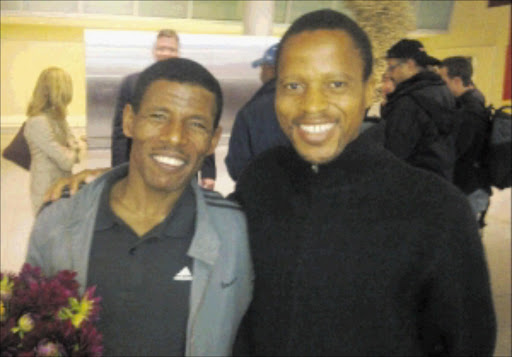 Great friends       : Haile Gebreselassie, left, with long-time friend Hendrick Ramaala.             PHOTO: SUPPLIED