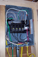 Photo: Finally! Some wiring pictures! Here's a shot of the sub-panel inside the shed. The panel is capable for being wired with 100 amps, but we've wired it for 80 (4-20 amp circuits). Each circuit powers a separate outlet in the shed. Great job, dad!