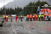Passengers are helped out of a rescue helicopter after being rescued from cruise ship Viking Sky in Hustadvika, Norway, on March 24 2019.