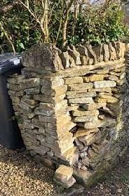 a dry stone wall thats started collapsing after being hit my a delivery van