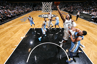 Photo: Gerald Wallace #45 of the Brooklyn Nets goes up for the easy layup against the Denver Nuggets at the Barclays Center on February 13, 2013 in Brooklyn, NY.